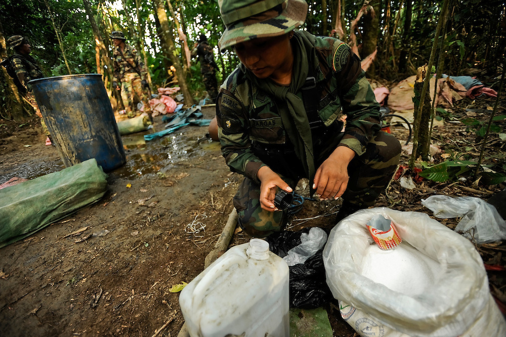 "Bolivian FELCN Special Forces police confiscate cocaine-base making chemicals found during raid at a cocaine processing lab in the outskirts of Villa Nuevo Horizonte, a dangerous area in the department of Santa Cruz were narcotraffiking runs rampant. FELCN officials report it is the area of Bolivia most thickly dense of narcotraffickers and cocaine-base processing laboratories.  FELCN police commonly referred to it as a ""narco pueblo""."