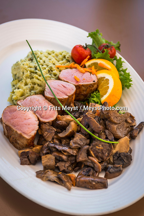 Balatonfured, Balaton, Hungary, August 2015. Veal medallions at Vitorlás Étterem Restaurant. Balatonfüred is a popular resort town situated on the northern shore of Lake Balaton. It is considered to be the capital of the Northern lake shore and is a popular yachting destination.Lake Balaton is a freshwater lake in the Transdanubian region of Hungary. It is the largest lake in Central Europe and one of the region's foremost tourist destinations. The mountainous region of the northern shore is known both for its historic character and as a major wine region, while the flat southern shore is known for its resort towns. Photo by Frits Meyst / MeystPhoto.com