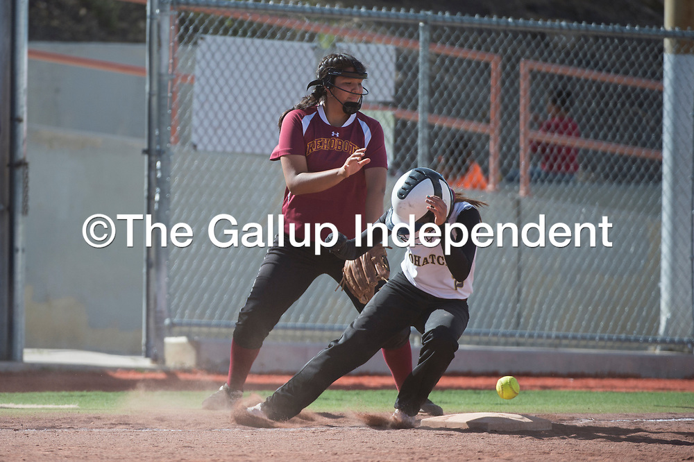 Tohatchi Cougar Krystal Benally (2) lands on third base before Rehoboth Lynx can catch the ball Tuesday in Gallup.
