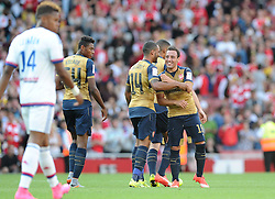 Santi Cazorla of Arsenal celebrates with team mates  - Mandatory by-line: Joe Meredith/JMP - 25/07/2015 - SPORT - FOOTBALL - London,England - Emirates Stadium - Arsenal v Lyon - Emirates Cup