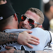 NEW YORK, NEW YORK - June 01:  Jerry Sands #41 of the Chicago White Sox and Brett Lawrie #15 of the Chicago White Sox hug in the dugout before the Chicago White Sox  Vs New York Mets regular season MLB game at Citi Field on June 01, 2016 in New York City. (Photo by Tim Clayton/Corbis via Getty Images)