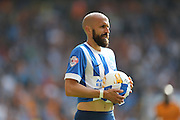Brighton defender, Bruno Saltor prepares to take a throw during the Sky Bet Championship match between Wolverhampton Wanderers and Brighton and Hove Albion at Molineux, Wolverhampton, England on 19 September 2015.