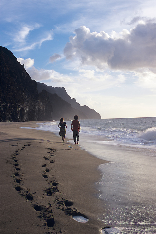 Kalalau Beach, Kauai, couple walking west down beach