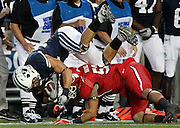 BYU running back Bryan Kariya (33) is tackled by Utah linebacker Matt Martinez (52) after catching a pass for a first down during the first half of an NCAA college football game, Saturday, Sept. 17, 2011, at LaVell Edwards Stadium in Provo, Utah. (AP Photo/Colin E Braley)..