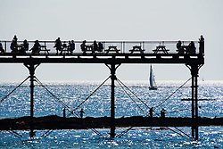 © London News Pictures. 15/08/2016. Aberystwyth .UK.<br /> People on the seaside pier  enjoying a day of hot sunshine in Aberystwyth on the west wales Coast. <br />  The weather is set to improve over the next two days, culminating in a mini-heatwave on Wednesday, with temperatures forecast to reach the high 20s or low 30s centigrade. Photo credit: Keith Morris/LNP
