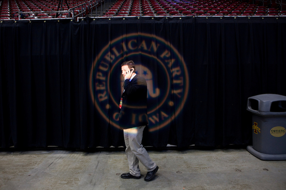 A man talks on the phone in the reporters' filing area at the Republican presidential debate on Thursday, August 11, 2011 in Ames, IA.