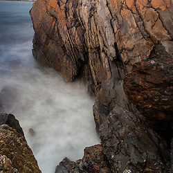 Rocks and surf at Wallis Sands State Park in Rye, New Hampshire.