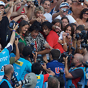 Michael Phelps, USA,  with his now traditional visit to mum in the stands after winning the men's 100m Butterfly at the World Swimming Championships in Rome on Saturday, August 01, 2009. Photo Tim Clayton.