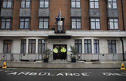 © Licensed to London News Pictures. 08/04/2018. London, UK. Police officers stand at the front door as The Duke of Edinburgh spends a 5th day in the King Edward VII Hospital as he recovers from a hip operation. Photo credit: Peter Macdiarmid/LNP
