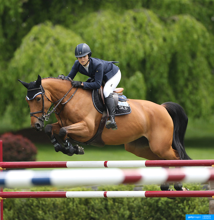 Adreinne Sternlight riding Raia D' Helby in action during the $35,000 Grand Prix of North Salem presented by Karina Brez Jewelry during the Old Salem Farm Spring Horse Show, North Salem, New York, USA. 15th May 2015. Photo Tim Clayton