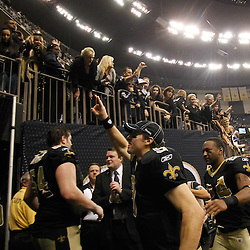 January 1, 2012; New Orleans, LA, USA; New Orleans Saints quarterback Drew Brees (9) celebrates after a win over the Carolina Panthers in a game at the Mercedes-Benz Superdome. The Saints defeated the Panthers 45-17. Mandatory Credit: Derick E. Hingle-US PRESSWIRE