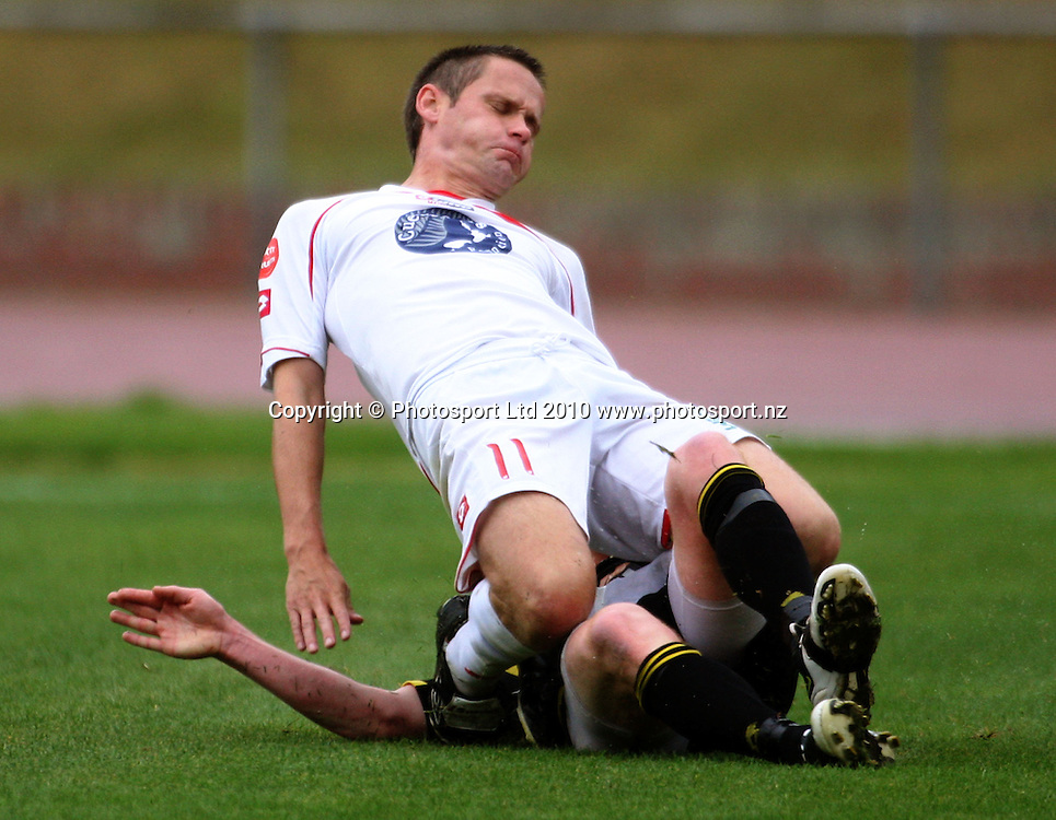 Waitakere's Neil Sykes collides with Roddy brown.<br /> NZFC soccer  - Team Wellington v Waitakere United at Newtown Park, Wellington. Sunday, 4 April 2010. Photo: Dave Lintott/PHOTOSPORT