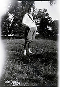 young adult female standing in girl scout clothing outdoors rural