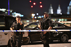 """Armed Police officers on London Bridge as police are dealing with a """"major incident"""" at London Bridge."""