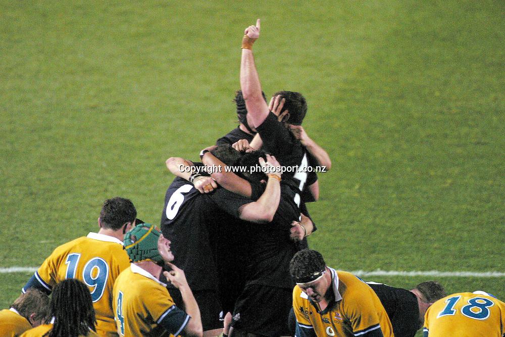 16th August, 2003. Eden Park, Auckland, New Zealand. Bledisloe Cup Match. New Zealand v Australia.<br />Reuben Thorne celebrates with Keven Mealamu and Chris Jack.<br />The All Blacks won the match, 21 - 17.<br />Pic: Hannah Johnston/Photosport
