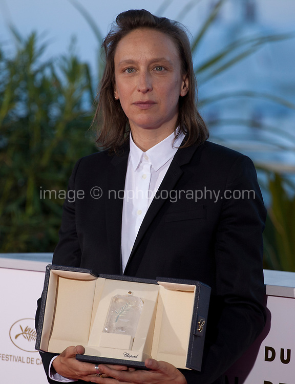 Celine Sciamma, winner of the Best Screenplay award for the film Portrait of a Lady on Fire (Portrait de la Jeune Fille en Feu) at the Palme D'Or Award photo call at the 72nd Cannes Film Festival, Saturday 25th May 2019, Cannes, France. Photo credit: Doreen Kennedy