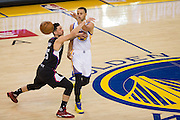 Golden State Warriors guard Stephen Curry (30) passes the ball past LA Clippers guard Austin Rivers (25) at Oracle Arena in Oakland, Calif., on February 23, 2017. (Stan Olszewski/Special to S.F. Examiner)