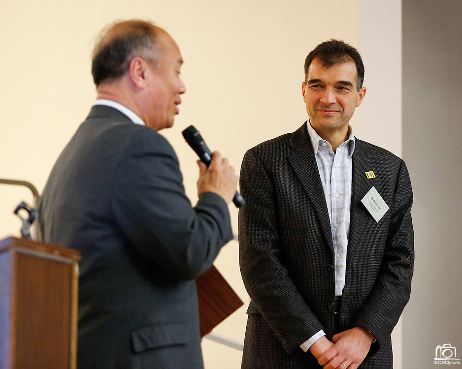 KLA-Tencor Vice President Oreste Donzella, right, accepts a plaque of gratitude from Milpitas Mayor Jose Esteves during the KLA-Tencor Computer Lab opening ceremony at Zanker Elementary School in Milpitas, California, on February 27, 2013. (Stan Olszewski/SOSKIphoto)