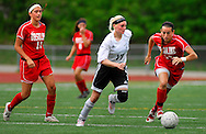 1 MAY 2010 -- O'FALLON, MO. -- Francis Howell North High School girls' soccer player Becky Lackey (17) breaks past Ursuline defenders Molly Huber (11) and Lindsay Elking (19) during the championship game of the 19th Annual St. Dominic / Howell North Shootout Saturday, May 1, 2010 at St. Dominic High School in O'Fallon, Mo. Ursuline beat Howell North 2-1. Photo © copyright 2010 by Sid Hastings.