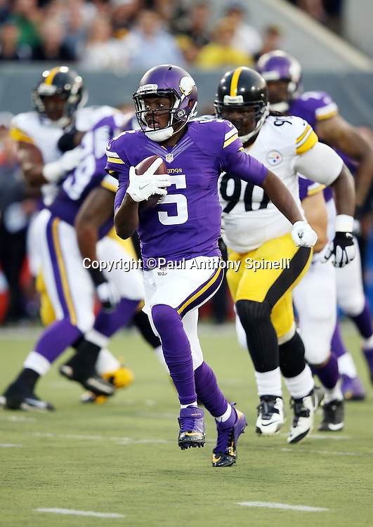 Minnesota Vikings quarterback Teddy Bridgewater (5) runs the ball for a gain of 6 yards during the 2015 NFL Pro Football Hall of Fame preseason football game against the Pittsburgh Steelers on Sunday, Aug. 9, 2015 in Canton, Ohio. The Vikings won the game 14-3. (©Paul Anthony Spinelli)