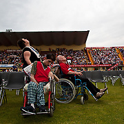 Italy, Biella- XVIII Special Olympics National Games for mentally disabled people: watching parachutists landing during opening ceremony ©2012 Mama2