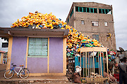 Plastic containers on rooftop in Shire Inda Selassie in Tigray Region, Northern Ethiopia, 2015. In the background is an incomplete concrete brick building. The population of Shire Inda Selassie was 47 000 in 2007 and by 2015 it had grown by almost 80% to 70, 800 (http://www.citypopulation.de/Ethiopia.html).<br /> Studies1 corroborate this visual yanecdotal evidence  that a significant number of people depend on the collection and recycling of plastics as an informal means of income. This informal economy is one the government ignores. <br /> <br /> Bjerkil 2005 Cycle of Plastic Waste. Masters Thesis. Norwegian University of Science and Technology<br /> <br /> http://wiego.org/sites/wiego.org/files/publications/files/Bjerkli-Cycle-of-Plastic-Waste-Addis-Ethiopia.pdf
