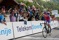 Winner Radoslav Rogina (CRO) of Adria Mobil celebrates at finish line at Vrsic during Stage 3 from Skofja Loka to Vrsic (170 km) of cycling race 20th Tour de Slovenie 2013,  on June 15, 2013 in Slovenia. (Photo By Vid Ponikvar / Sportida)