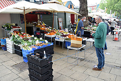 Social distancing measures in operation in Norwich market during Coronavirus lockdown, UK June 2020. Fruit & veg stall