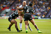 Leeds Rhinos second row Carl Ablett (12) is tackled during the Challenge Cup 2017 semi final match between Hull RFC and Leeds Rhinos at the Keepmoat Stadium, Doncaster, England on 29 July 2017. Photo by Simon Davies.