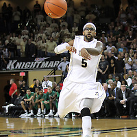 Central Florida guard Marcus Jordan (5) passes the ball during a Conference USA NCAA basketball game between the Marshall Thundering Herd and the Central Florida Knights at the UCF Arena on January 5, 2011 in Orlando, Florida. Central Florida won the game 65-58 and extended their record to 14-0.  (AP Photo/Alex Menendez)