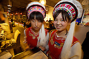 Huhai and Qianhai Lake nightlife district. Waitresses in tribal costumes at South Silk Road, a trendy restaurant.