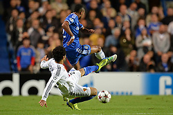 LONDON, ENGLAND - September 18: Basel's Mohamed Salah fouls Chelsea's Ashley Cole  during the UEFA Champions League Group E match between Chelsea from England and Basel from Switzerland played at Stamford Bridge, on September 18, 2013 in London, England. (Photo by Mitchell Gunn/ESPA)