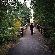 A woman walks her dog along the Mammoth Lakes bikepath on a early Fall evening.