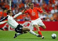 Photo: Scott Heavey, Digitalsport<br /> NEDERLAND v TYSKLAND. Group D, UEFA European Championship 2004. 15/06/2004.<br /> Dietmar Hamann slides in on Bolo Zenden