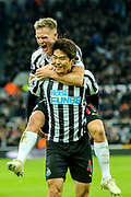 Ki Sung-Yueng (#4) of Newcastle United and Matt Ritchie (#11) of Newcastle United celebrate Newcastle United's first goal (1-0) scored by Ayoze Perez (#17) of Newcastle United and assisted by Ki Sung-Yueng (#4) of Newcastle United during the Premier League match between Newcastle United and Watford at St. James's Park, Newcastle, England on 3 November 2018.