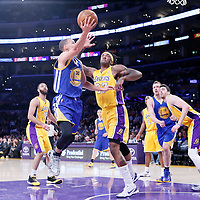 11 April 2014: Golden State Warriors guard Stephen Curry (30) goes for the layup over Los Angeles Lakers forward Jordan Hill (27) during the Golden State Warriors 112-95 victory over the Los Angeles Lakers at the Staples Center, Los Angeles, California, USA.
