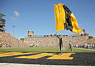 """September 21 2013: An Iowa Hawkeyes cheerleader raises an """"A"""" flag after a touchdown score during the first quarter of the NCAA football game between the Western Michigan Broncos and the Iowa Hawkeyes at Kinnick Stadium in Iowa City, Iowa on September 21, 2013. Iowa defeated Western Michigan 59-3."""