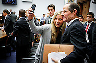 "A young woman stops for a picture with former Governor Eliot Spitzer (D-NY) (right) after he watched U.S. Treasury Secretary Timothy Geithner's (left) testimony before the House Financial Services Committee on Capitol Hill in Washington, July 25, 2012. Geithner, under pressure for not doing enough to stop fraudulent manipulation of a key benchmark interest rate, told lawmakers on Wednesday he alerted the appropriate authorities ""early on.""    REUTERS/Jonathan Ernst    (UNITED STATES)"
