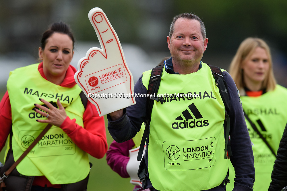 Marshals on their way to start their day's work at Blackheath. The Virgin Money London Marathon, 23rd April 2017.<br /> <br /> Photo: Joe Toth for Virgin Money London Marathon<br /> <br /> For further information: media@londonmarathonevents.co.uk
