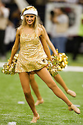 NEW ORLEANS, LA - DECEMBER 26:   Cheerleader of the New Orleans Saints performs in her Christmas outfit during a game against the Atlanta Falcons at Mercedes-Benz Superdome on December 26, 2011 in New Orleans, Louisiana.  The Saints defeated the Falcons 45-16.  (Photo by Wesley Hitt/Getty Images) *** Local Caption ***