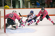Pittsford defender Erik Barkstrom pursues Alex Schoepfel of Fairport on a breakaway as goaltender Danny Kelly makes the save during a game at RIT on Saturday, January 24, 2015.