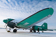 Yellowknife, Northwest Territories, Canada, February 2012. The Douglas DC-3, otherwise known as a C-47, Dakota, or Gooney Bird, made its first flight on December 17, 1935, over sixty years ago. Since that day, DC-3's have been flying all over the world, hauling freight and passengers to every corner of the globe. This aircraft went into production at a time of war, the second World War. The 1940's 1950's vintage transport aircraft of Buffalo Airways service the remote airstrips in the Arctic outposts and villages of Northern Canada. They have been immortalized by Ice Pilots NWT, the popular reality TV series. Photo by Frits Meyst/Adventure4ever.com