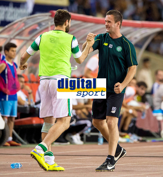 05/08/15 UEFA CHAMPIONS LEAGUE 3RD QUALIFIER 2ND LEG<br /> QARABAG FK V CELTIC<br /> TOFIQ BAHARMOV STADIUM - BAKU<br /> Celtic manager Ronny Deila (right) celebrates with Nadir Ciftci at full-time