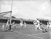 Dublin send the fall flying past the Kerry goalie and into the net during the All Ireland Senior Gaelic Football Final Kerry v Dublin in Croke Park on the 25th September 1955. Kerry 00-12 Dublin 01-06.