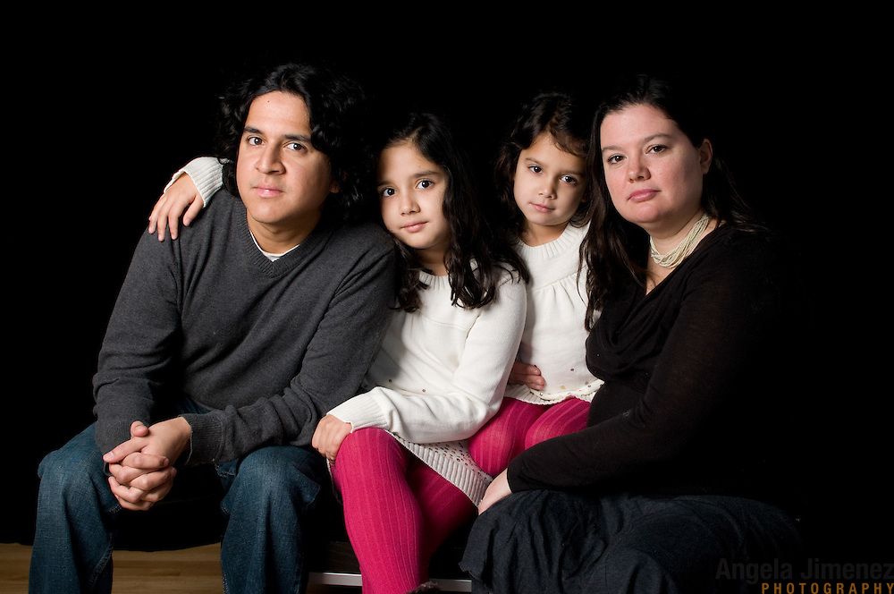 The O'Connor family is photographed in a family child children studio portrait session at The Brooklyn Arts Exchange in Brooklyn, New York on December 17, 2011. ..Photograph by Angela Jimenez .Angela Jimenez Photography.www.angelajimenezphotography.com