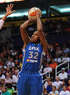 Sep 25, 2011; Phoenix, AZ, USA; Minnesota Lynx forward Rebekkah Brunson (32) reacts on the court while playing Phoenix Mercury at the US Airways Center. The Lynx defeated the Mercury 103-86. Mandatory Credit: Jennifer Stewart-US PRESSWIRE