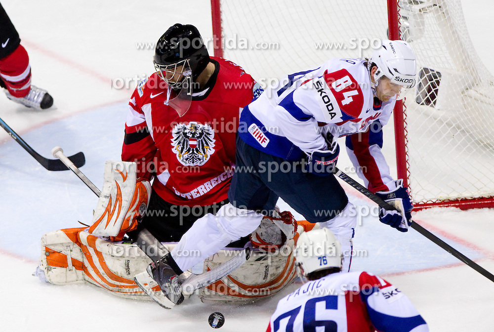 Fabian Weinhandl of Austria and Andrej Hebar of Slovenia during ice-hockey match between Austria and Slovenia of Group G in Relegation Round of IIHF 2011 World Championship Slovakia, on May 7, 2011 in Orange Arena, Bratislava, Slovakia. (Photo By Vid Ponikvar / Sportida.com)