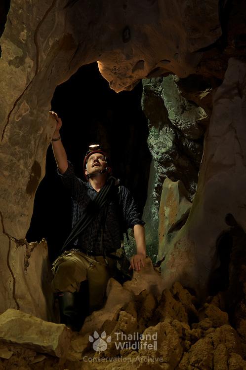 A caver exploring the limestone caves of Khao Wong National Park Khao Chamao-Khao Wong) in Rayong, Thailand. April 2009