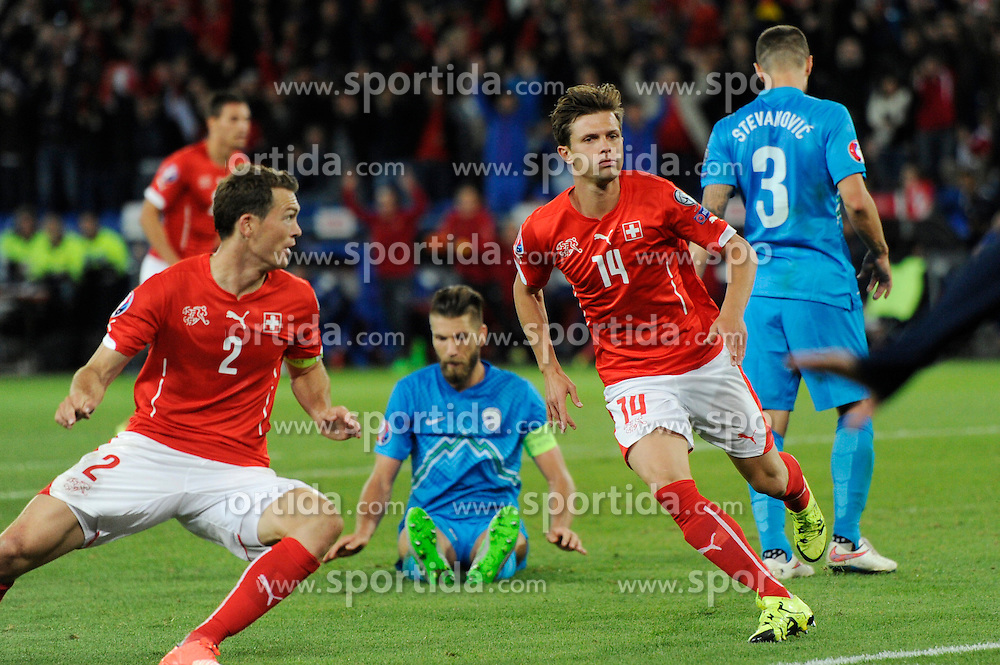 05.09.2015, St. Jakob Park, Basel, SUI, UEFA Euro 2016 Qualifikation, Schweiz vs Slowenien, Gruppe E, im Bild Valentin Stocker (SUI, right) scores 2:2 // during the UEFA EURO 2016 qualifier group E match between Switzerland and Slovenia at the St. Jakob Park in Basel, Switzerland on 2015/09/05. EXPA Pictures &copy; 2015, PhotoCredit: EXPA/ Freshfocus/ Steffen Schmidt<br /> <br /> *****ATTENTION - for AUT, SLO, CRO, SRB, BIH, MAZ only*****