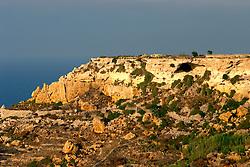 MALTA GOZO RAMLA 24JUL06 - Rock formation on the edge of Ramla Valley above the sandy beach of Ramla...jre/Photo by Jiri Rezac..© Jiri Rezac 2006..Contact: +44 (0) 7050 110 417.Mobile:  +44 (0) 7801 337 683.Office:  +44 (0) 20 8968 9635..Email:   jiri@jirirezac.com.Web:    www.jirirezac.com